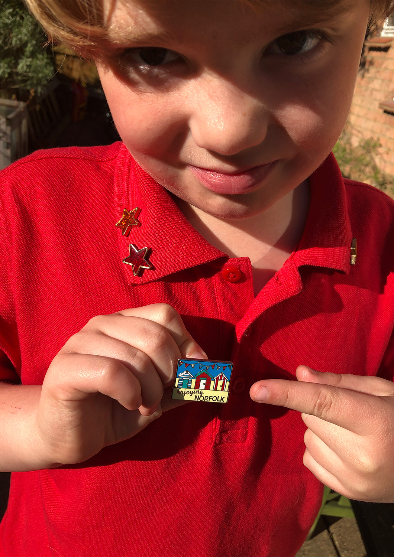 Enjoying Norfolk Kids Summer Virtual Challenge pin badge.